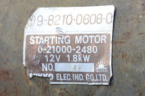 「いすゞ」と書いてあります。 日興電機工業株式会社のスターターモーターではないでしょうか?